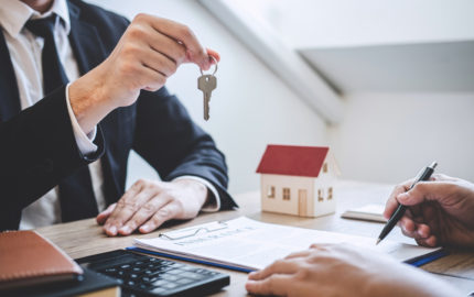 guy handing key to client